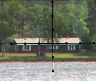 magnified reticle view of house